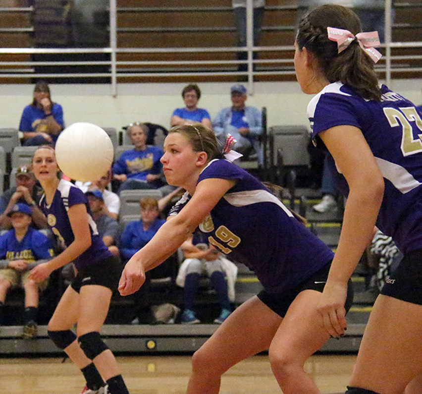 ROSS MARTIN/Citizen photos North Platte senior Katie Heese hits a pass during the Panthers match against East Buchanan on Thursday, Oct. 1 at North Platte High School in Dearborn, Mo.