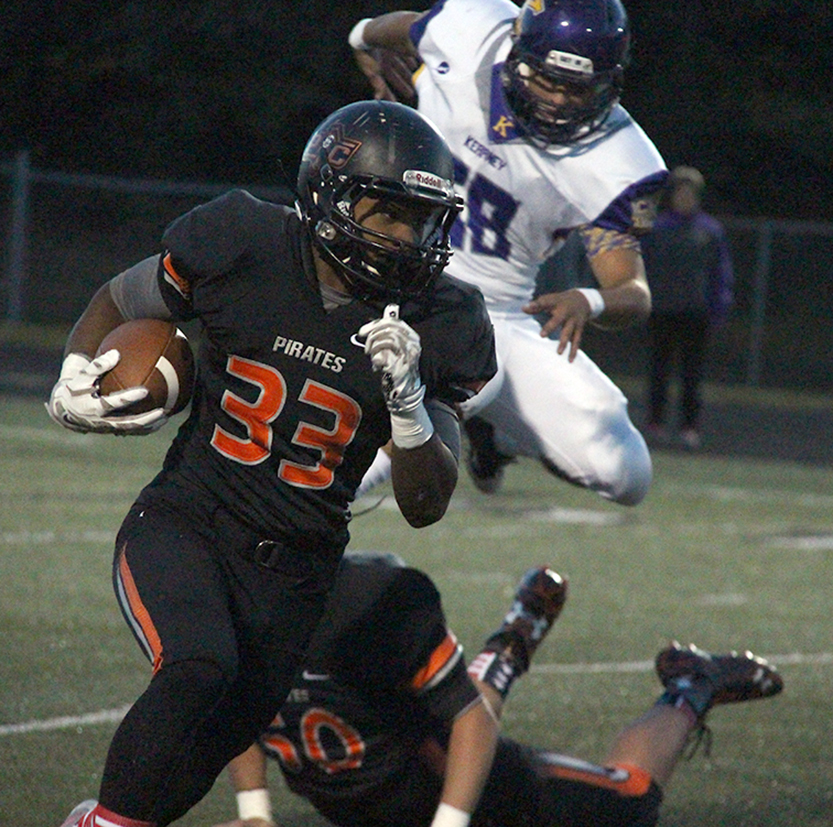 ROSS MARTIN/Citizen photo Platte County running back Mike McNair (33) turns to run up field against Kearney on Friday, Oct. 2 at Pirate Stadium.