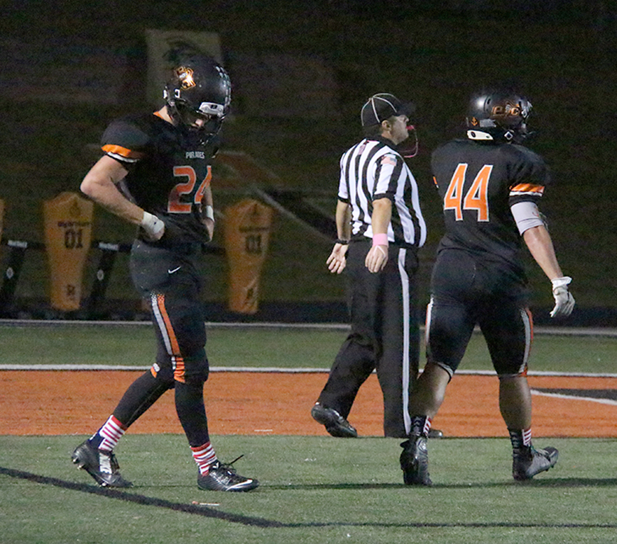 ROSS MARTIN/Citizen photo Platte County senior defensive back Johnny Blankenship, left, walks off the field following Kearney's final score of a 36-0 win against Platte County on Friday, Oct. 2 at Pirate Stadium.
