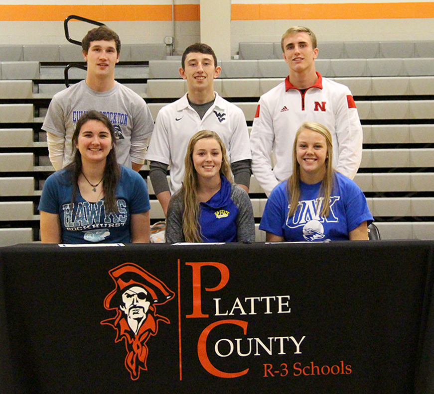 ROSS MARTIN/Citizen photo Front row, from left: Rachel Holden, Alexis Ray and Mallory Stoner and back row, from left: Matt Madill, Matthew Schmitt and Johnny Blankenship were honored at a signing ceremony held Thursday, Nov. 19 at Platte County High School. Each of them signed to play sports in college.