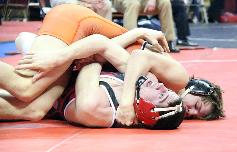 ROSS MARTIN/Citizen photo Platte County junior Ethan Karsten pins McDonald County's Josh Kinser in the first period of a 145-pound semifinal match on Friday, Feb. 20 during the Class 3 Missouri State Wrestling Championships at Mizzou Arena in Columbia, Mo.