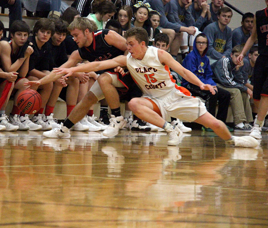 ROSS MARTIN/Citizen photo Platte County senior Jerod Thomas (15) and Chillicothe senior guard Mason Hayward battle for a loose ball in the opening round of the Savannah Invitational on Monday, Nov. 30 at Savannah High School in Savannah, Mo.