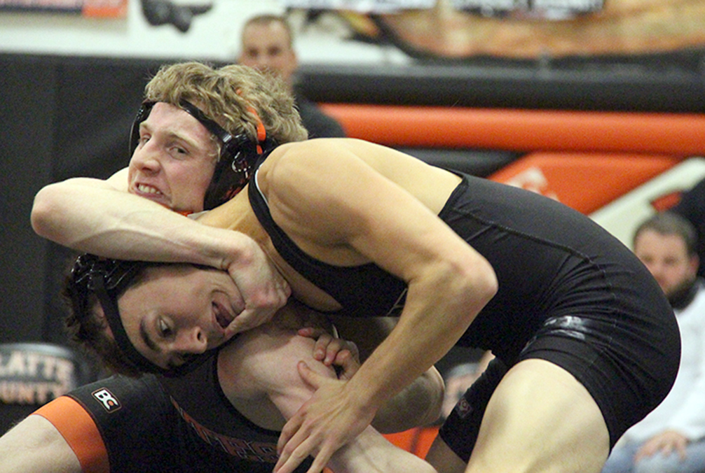 ROSS MARTIN/Citizen photo Platte County senior Trey Dockery looks to grab the opposite leg of Raymore-Peculiar's Shawn Wright during a 126-pound match in a dual Thursday, Dec. 3 at Platte County High School.