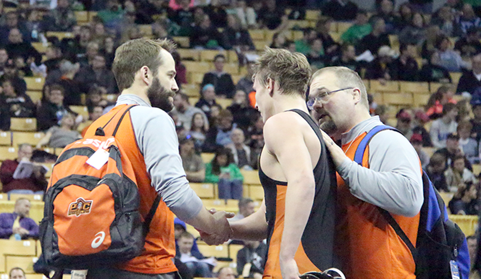 ROSS MARTIN/Citizen photo Platte County coaches Kiel Giese, left, and Reggie Burress, right, talk with junior Johnny Blankenship after he lost the  160-pound championship match to Neosho's Sam Williams during the Class 3 Missouri State Wrestling Championships on Saturday, February 21 at Mizzou Arena in Columbia, Mo.