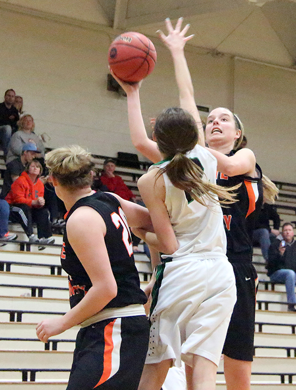 ROSS MARTIN/Citizen photo Platte County forward Madysen Fine, rear, attempts a shot against Smithville during the opening round of the Class 4 District 16 Tournament on Saturday, Feb. 28 at Savannah High School in Savannah, Mo.