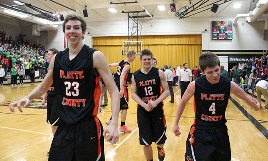 ROSS MARTIN/Citizen photo Platte County players Nick Kunels (left), Tyler Clemens (center) and Kodee Martin walk off the court after the Pirates beat St. Joseph Lafayette 52-51 in a Class 4 District 16 semifinal Thursday, March 5 at Savannah High School in Savannah, Mo.