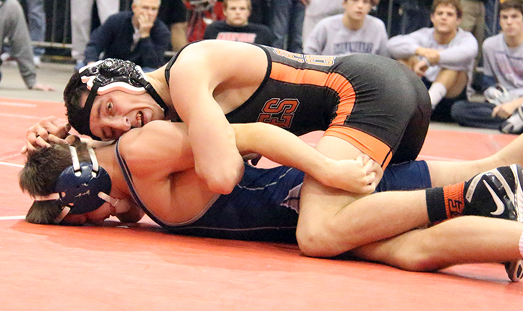 ROSS MARTIN/Citizen photo Platte County senior Matthew Schmitt, top, holds down Mill Valley's Conner Ward during a 126-pound semifinal Saturday, Dec. 19 in the Kansas City Stampede held at Hale Arena in Kansas City, Mo. Schmitt went on to become the Pirates' first two-time Stampede champion.