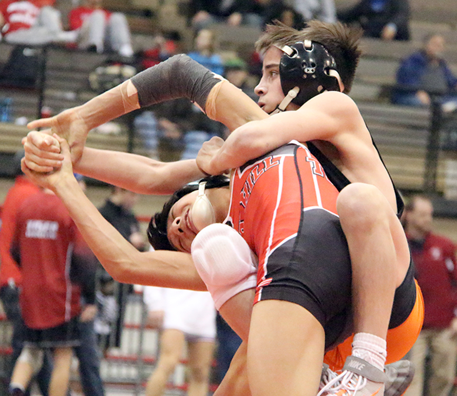 ROSS MARTIN/Citizen photo Platte County sophomore Cody Phippen, right, works to control Park Hill sophomore Kelvin Eblen during the 106-pound championship match in the Kansas City Stampede at Hale Arena in Kansas City, Mo. Phippen won a 3-1 decision, the first of three individual titles for the Pirates.