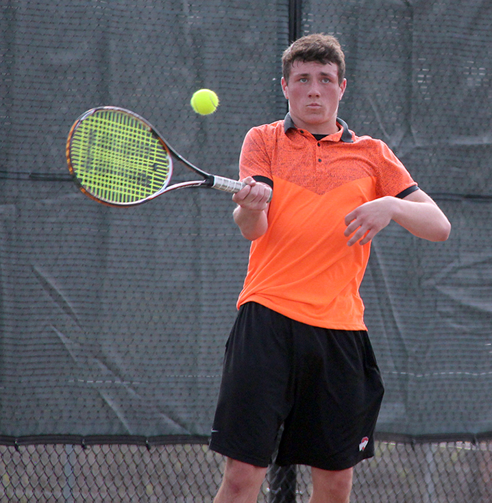 ROSS MARTIN/Citizen photo Platte County's Spencer Kunz hits a return during a match against Winnetonka on Thursday, April 2 at Winnetonka High School in Kansas City, Mo.