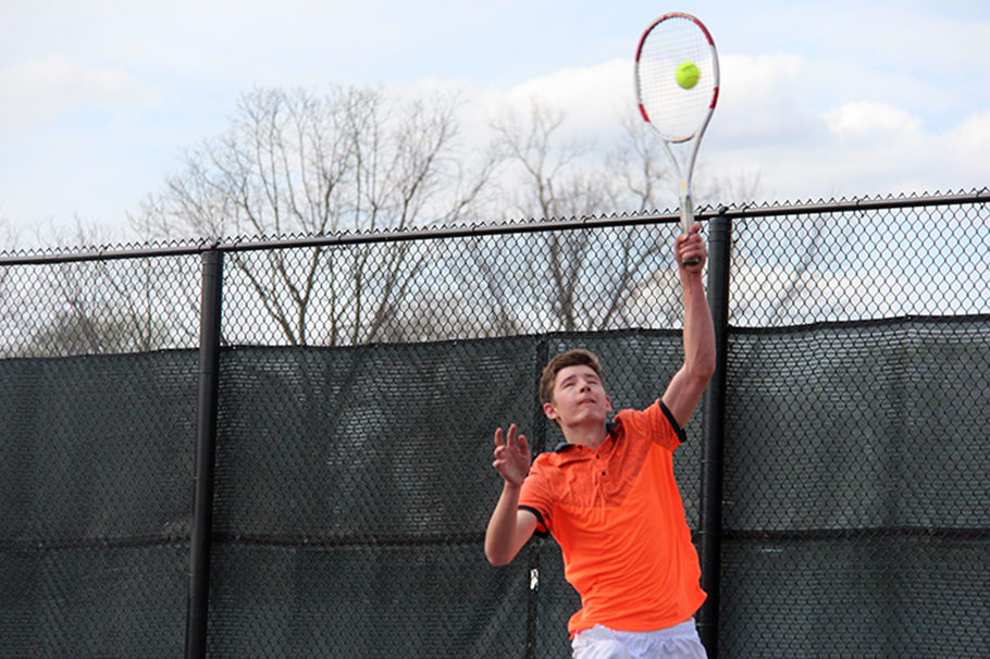 ROSS MARTIN/Citizen photo Platte County senior Parker Ward hits a serve during his No. 1 singles match in a dual against Winnetonka on Thursday, April 2 at Winnetonka High School in Kansas City, Mo.