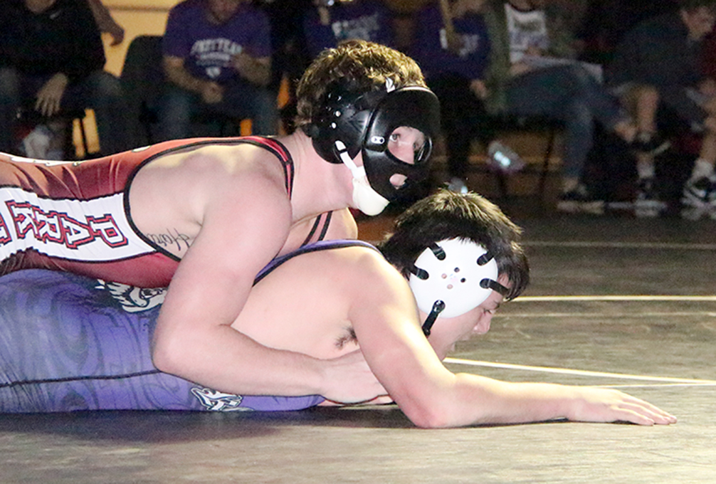 ROSS MARTIN/Citizen photo Park Hill senior Sean Hosford, top, wore a protective mask due to a broken nose during a 152-pound match in a dual with Kearney on Friday, Jan. 8 at Park Hill High School in Kansas City, Mo.