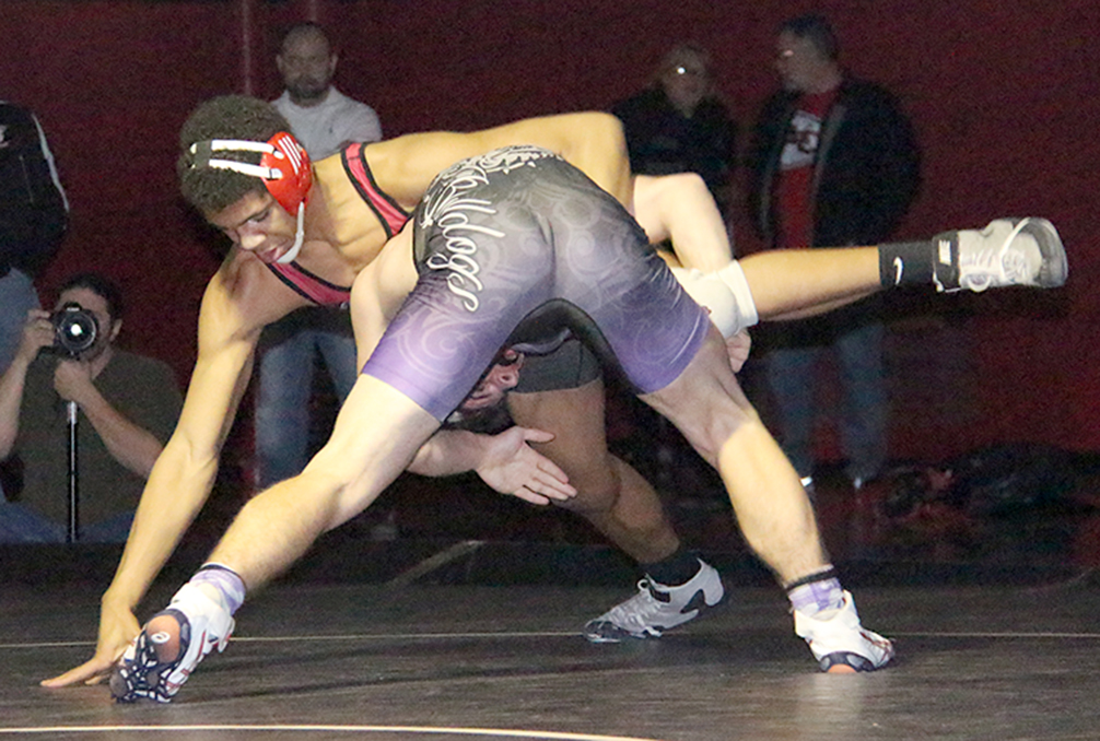 ROSS MARTIN/Citizen photo Park Hill freshman Devin Winston, rear, puts a hand down to keep his balance during a 170-pound match against Kearney's Matthew Witthar on Friday, Jan. 8 at Park Hill High School in Kansas City, Mo.