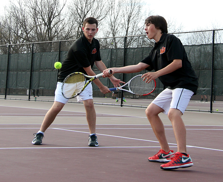 ROSS MARTIN/Citizen photo Platte County's Jack Lawver, right, hits a return while doubles partner Andy Day looks on during a match against Winnetonka on Thursday, April 2 at Winnetonka High School in Kansas City, Mo.