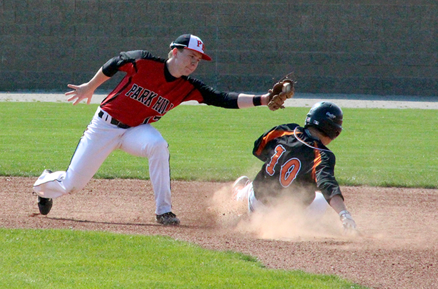ROSS MARTIN/Citizen photo Park Hill second baseman Lucas Youtsey, left, attempts to tag a Platte County centerfielder Colton Horn during a game of the Northland Classic on Thursday, April 23 at Park Hill High School in Kansas City, Mo. Platte County won the game 5-1.