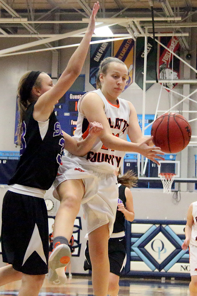ROSS MARTIN/Citizen photo Platte County freshman guard Jaycie Stubbs drops off a pass in the lane during the Oak Park Invitational third-place game against Park Hill South on Friday, Jan. 22 at Oak Park High School in Kansas City, Mo.