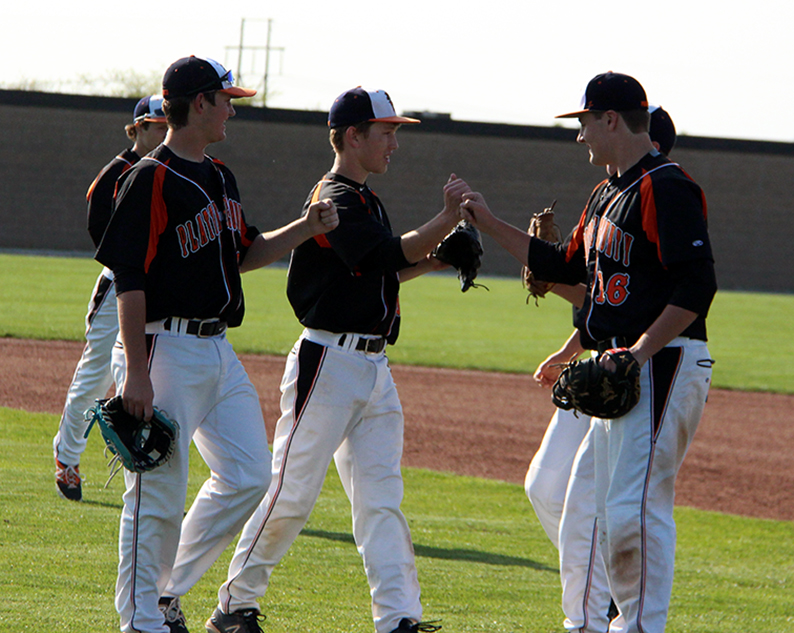 ROSS MARTIN/Citizen photo Members of the Platte County baseball team congratulate pitcher Matt Mefford, center, following a 5-1 win against Park Hill in the Northland Classic on Thursday, April 23 at Park Hill High School in Kansas City.