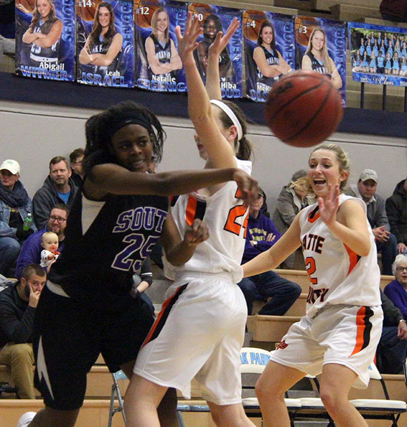 ROSS MARTIN/Citizen photo Park Hill South freshman Alecia Westbrook, left, throws a pass around a Platte County defender during the Oak Park Invitational third-place game Friday, Jan. 22 in Kansas City, Mo.