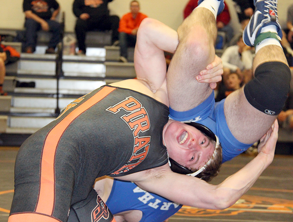 ROSS MARTIN/Citizen photo Platte County sophomore Dakota Schmidt, left, tries to finish a takedown on Carthage's Kale Vogt in a 170-pound match during the Platte County Invitational on Saturday, Jan. 23 at Platte County High School in Platte City.