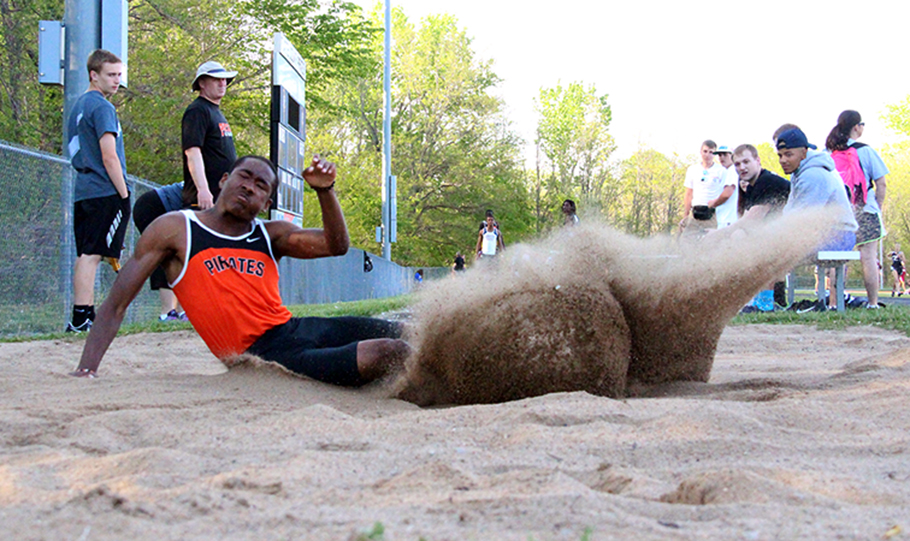 ROSS MARTIN/Citizen photo Platte County senior Aaron Brown lands in the sand while competing in the long jump during the Platte County Invitational on Wednesday, April 29 at Pirate Stadium. He finished third in the event.