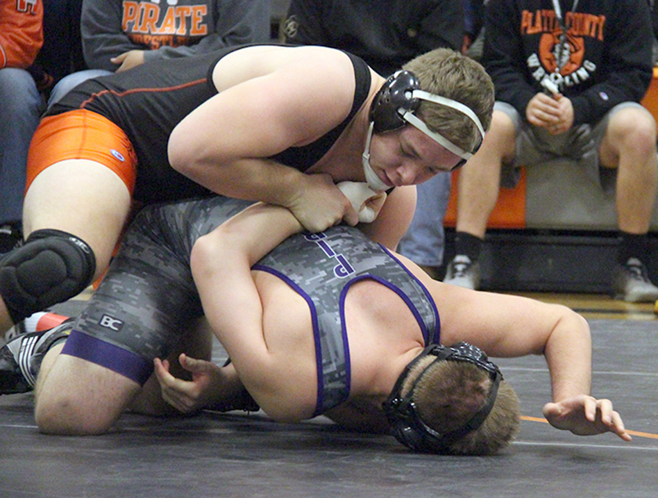 ROSS MARTIN/Citizen photo Platte County junior Casey Jumps works an arm bar on Belton's Dalton Crum during a 220-pound match in the Platte County Invitational on Saturday, Jan. 23 at Platte County High School in Platte City.