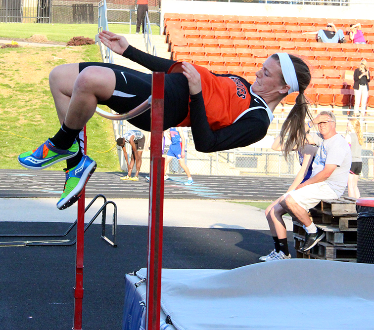 Platte County senior Shelly Laures clears the bar during the high jump at the Platte County Invitational on Wednesday, April 29 at Pirate Stadium.