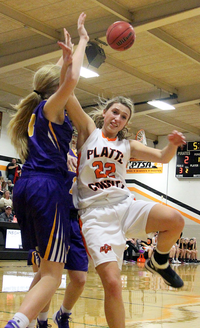 ROSS MARTIN/Citizen photo Platte County senior Lindsey Bogart, right, has her shot blocked in the Pirates game against Kearney on Thursday, Jan. 28 at Platte County High School.