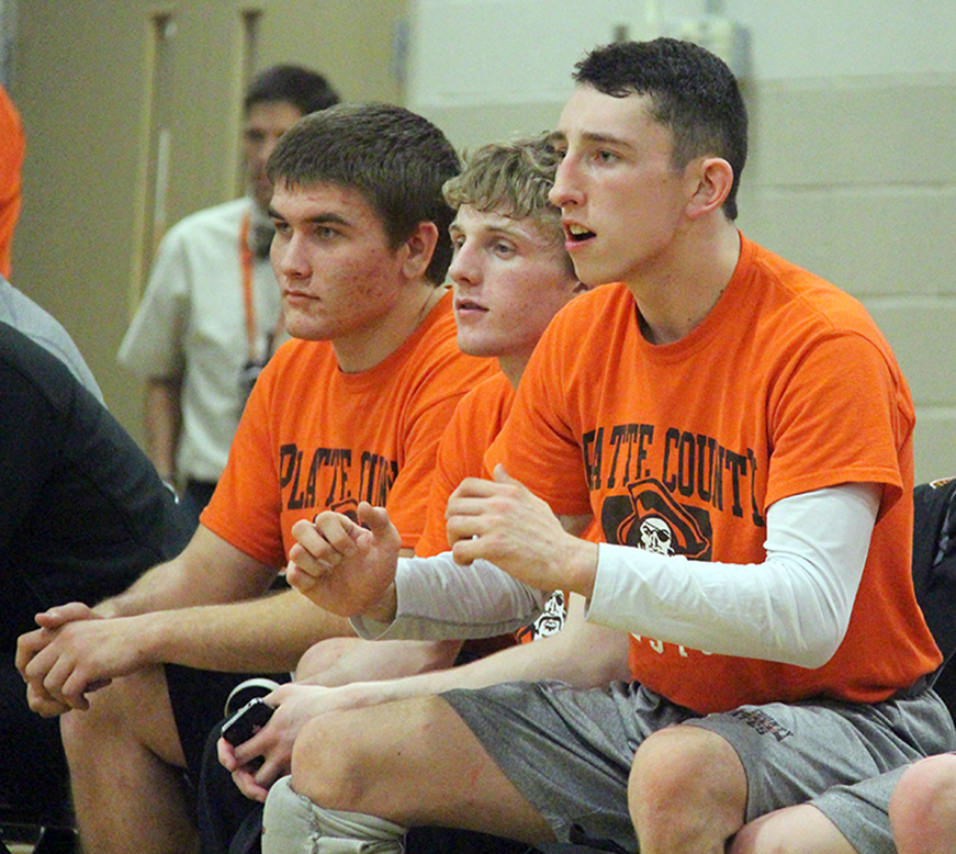 ROSS MARTIN/Citizen photo Platte County senior Matthew Schmitt, right, gives advice to a teammate during a dual with Kearney on Tuesday, Feb. 2. At left are fellow Pirates seniors Tyler Blankenship and Trey Dockery, part of a record-setting class.