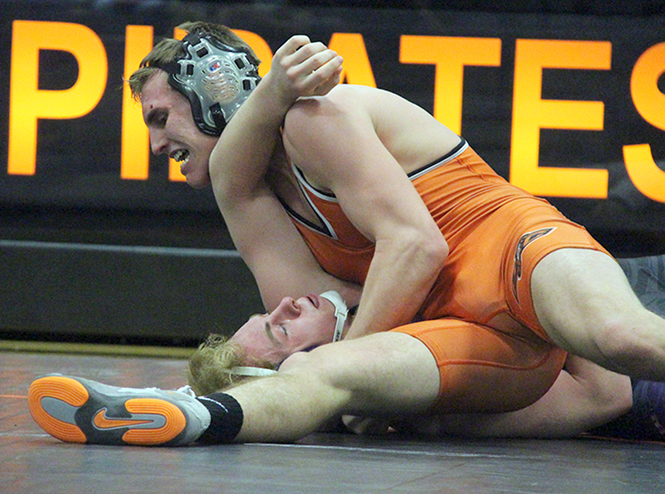 ROSS MARTIN/Citizen photo Platte County senior Johnny Blankenship, top, pins Kearney's Dylan Lewis in their 160-pound match during a dual Tuesday, Feb. 2 at Platte County High School. Blankenship will end his career fifth all-time in victories for Platte County. He's at 169 entering the postseason.