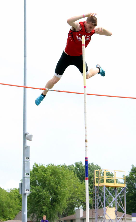 Park Hill junior Chris Nilsen clears the bar in the pole vault during the Class 5 District 8 meet held Saturday, May 16 at Kearney High School in Kearney, Mo. Nilsen bettered his own school record by clearing 16 feet on the way to winning the event.