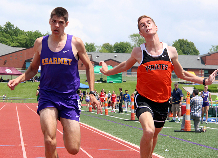 ROSS MARTIN/Citizen photo Platte County senior Nathan Straubel, right, leans for the finish line but comes in just behind Kearney's Clayton Adams in the 1,600-meter run during the Class 4 District 8 meet Saturday, May 16 at Kearney High School in Kearney, Mo.