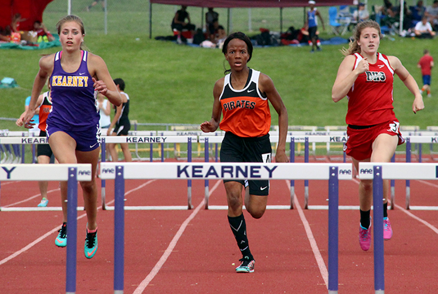 ROSS MARTIN/Citizen photo Platte County junior Hillary Mathurin, center, eyes the final hurdle during the 300-meter hurdles race in Saturday, May 16's Class 4 District 8 meet at Kearney High School in Kearney, Mo.