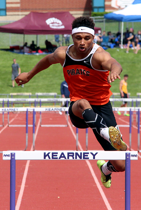 ROSS MARTIN/Citizen photo Platte County senior Aliek Reed clears jumps over the final hurdle during the 300-meter hurdles race in the Class 4 District 8 meet held Saturday, May 16 at Kearney High School in Kearney, Mo.