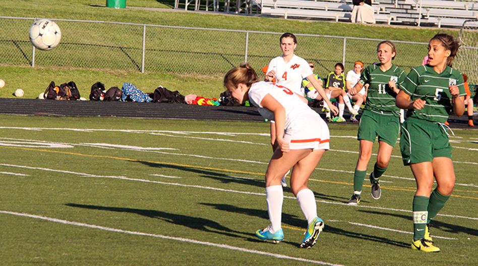 ROSS MARTIN/Citizen photo Platte County senior midfielder Teryn Scott watches her header, one of four goals she scored in a Class 3 District 16 matchup with St. Joseph Lafayette on Monday, May 18 at Smithville High School in Smithville, Mo.