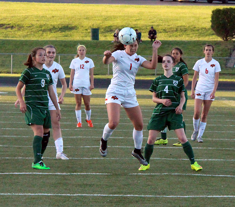 ROSS MARTIN/Citizen photo Platte County junior forward Brooke Zenner heads a pass forward during a Class 3 District 16 matchup with St. Joseph Lafayette on Monday, May 18 at Smithville High School in Smithville, Mo. Platte County won 10-0.