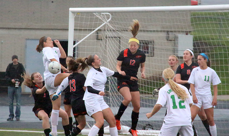 ROSS MARTIN/Citizen photo Platte County sophomore defender Amanda Sullivan, center, heads the ball clear on a Smithville corner kick during the Class 3 District 16 championship game Wednesday, May 20 at Smithville High School in Smithville, Mo.
