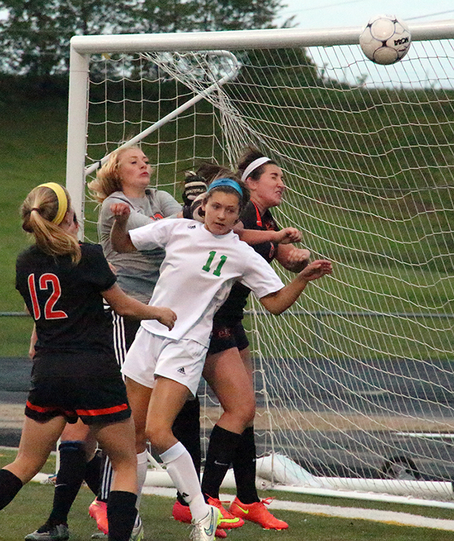 ROSS MARTIN/Citizen photo Platte County freshman goalkeeper Faith Burtchell, center, attempts to claim a cross during the Class 3 District 16 championship game against Smithville on Wednesday, May 20 at Smithville High School in Smithville, Mo.