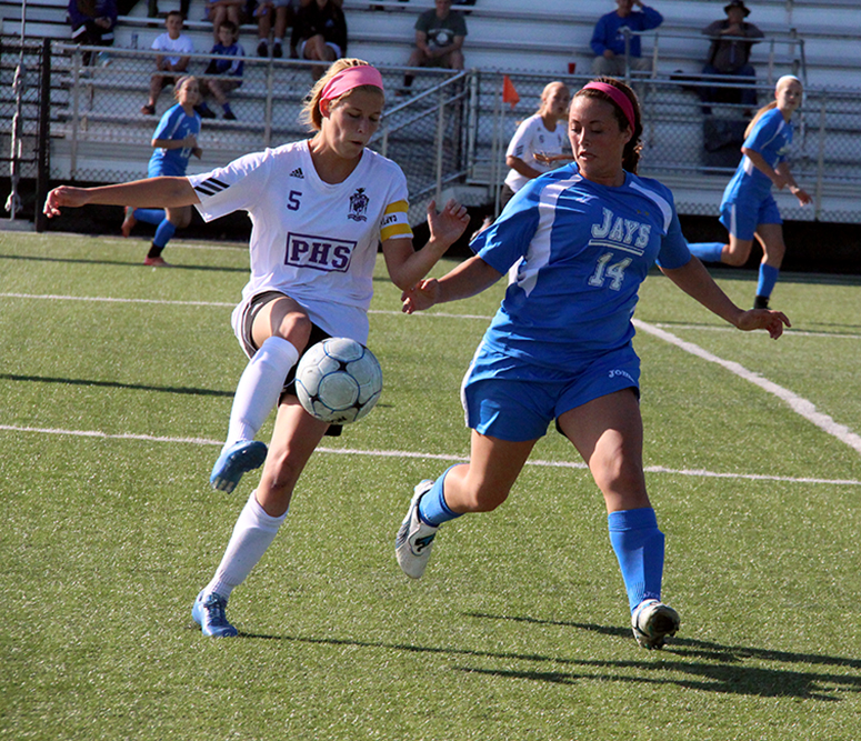 ROSS MARTIN/Citizen photo Park Hill South midfielder Anna Courtney, left, plays a ball around Liberty defender Marissa Adams during the Class 4 District 15 championship game Thursday, May 21 at Park Hill District Soccer Complex in Riverside, Mo.