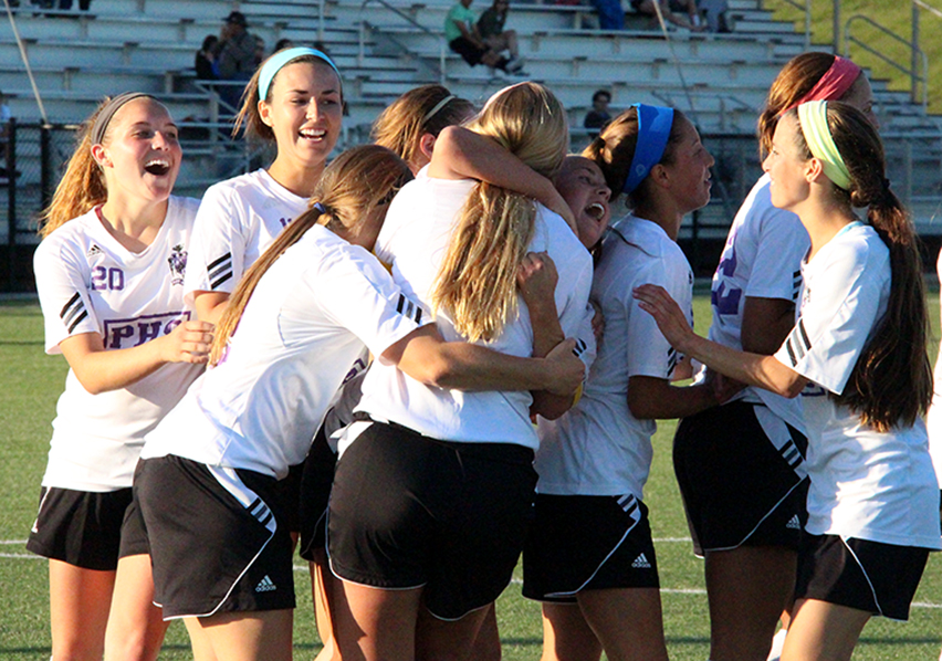 ROSS MARTIN/Citizen photo Park Hill South players mob teammate Shay Jackson, center, after her goal in the 89th minute delivered a 2-1 overtime win against Liberty on Thursday, May 21 at Park Hill District Soccer Complex in Riverside, Mo.
