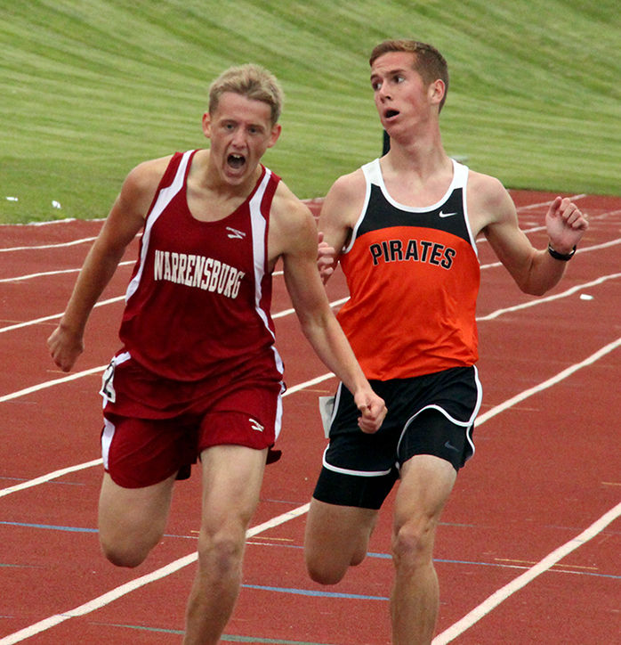 ROSS MARTIN/Citizen photo Platte County senior Nathan Straubel, right, finishes the 1,600-meter run just behind Warrensburg's Trent Classen during the Class 4 Sectional 4 meet on Saturday, May 23 at North Kansas City District Activities Complex in Kansas City, Mo.