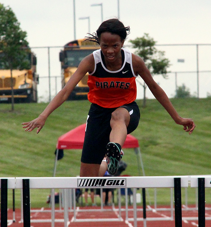 ROSS MARTIN/Citizen photo Platte County junior Hilary Mathurin clears the final hurdle in the 300-meter hurdles race during the Class 4 Sectional 4 meet Saturday, May 23 at North Kansas City District Activities Complex in Kansas City, Mo.