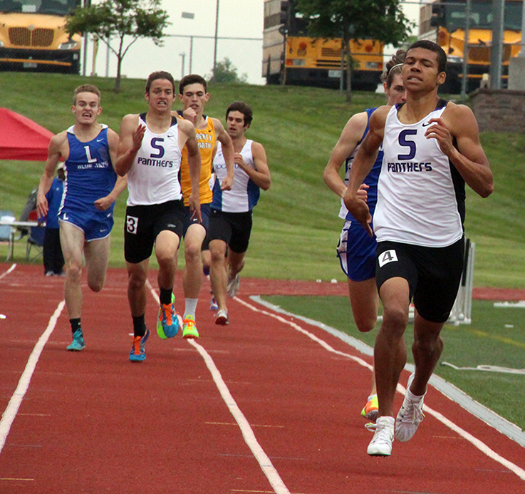 ROSS MARTIN/Citizen photos Park Hill South seniors Darrien Case, right, and Mitch Henderson, far left, race to the finish of the Class 5 Sectional 4 800-meter run on Saturday, May 23 at North Kansas City District Activities Complex in Kansas City, Mo.