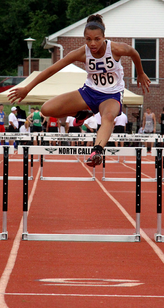 ROSS MARTIN/Citizen photo Park Hill South senior Jordan Hammon clears the final hurdle during a preliminary heat of the Class 5 300-meter hurdles competition on Friday. Hammond advanced to the final on Saturday and earned a seventh-place medal, the first of her career.