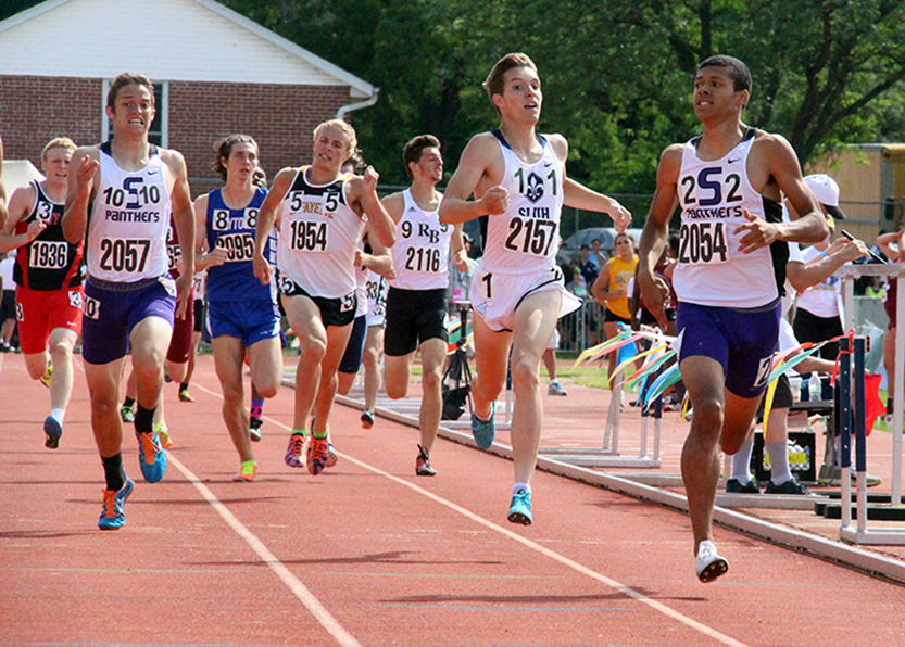 ROSS MARTIN/Citizen photo Park Hill South seniors Darrien Case, right and Mitch Henderson, left, run towards the finish line of the 800-meter run on Friday, May 29 during the Class 5 Missouri State Track and Field Championships at Dwight T. Reed Stadium in Jefferson City, Mo.