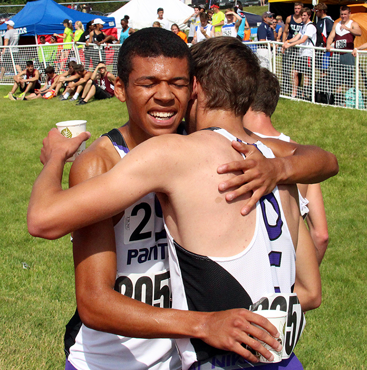 ROSS MARTIN/Citizen photo Park Hill South seniors Darrien Case, left and Mitch Henderson, hug after crossing the finish line of the 800-meter run on Friday, May 29 during the Class 5 Missouri State Track and Field Championships at Dwight T. Reed Stadium in Jefferson City, Mo. Case finished in 1 minute, 53.63 seconds to claim the state championship while Henderson finished fourth, a second behind his teammate.