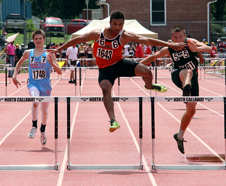 ROSS MARTIN/Citizen photo Platte County senior Aliek Reed clears a hurdle in the 300-meter hurdles final on Saturday, May 30 during the Class 4 Missouri State Track and Field Championships at Dwight T. Reed Stadium in Jefferson City, Mo.