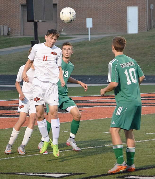 BRYCE MERENESS/Citizen photo Platte County senior defender Isaac Martin (11) heads a clearance away from goal in a match against Smithville on Monday, Sept. 28 at Pirate Stadium.