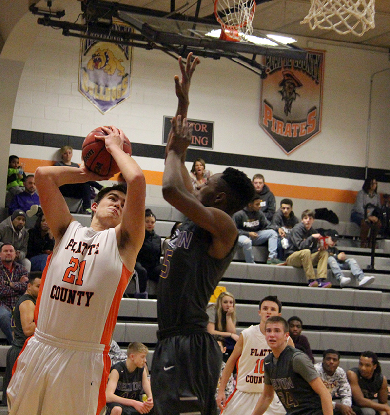 ROSS MARTIN/Citizen photo Platte County senior forward Jack Doole, left, goes up for a shot against Belton's Shawn Smith during a game Monday, Jan. 4 at Platte County High School in Platte City.
