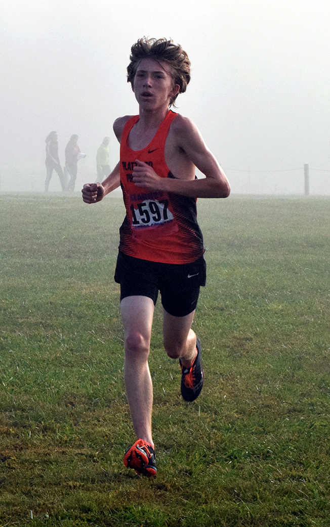 BRYCE MERENESS/Citizen photo Platte County freshman Jackson Letcher runs through the fog at the Suburban Conference Blue Division meet held Saturday, Oct. 10 at Jesse James Park in Kearney, Mo. Letcher continued his strong first season as a Pirates runner by finishing third in the meet while the Platte County boys finished in second place overall.