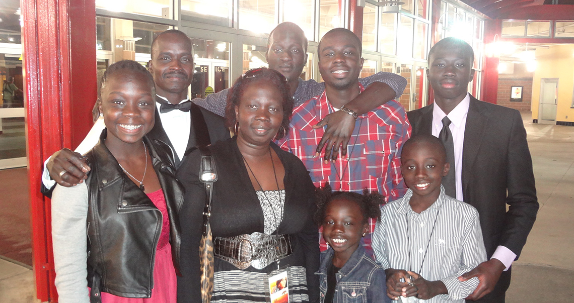 "Submitted photo Members of the Jale family (clockwise from front right), Guya, Heaven, Della, Keji, Elikana, Loku, Jaddy and Okwar pose together at the local premiere of ""The Good Lie"" on Sept. 22 at the AMC 30 in Olathe, Kan. Elikana, Okwar and Keji were in the movie, which chronicles a fictional story based on real events of Sudanese immigrants who settle in Kansas City. Elikana immigrated to the United States from Sudan in 1994 and now raises his children in the Platte County R-3 School District."