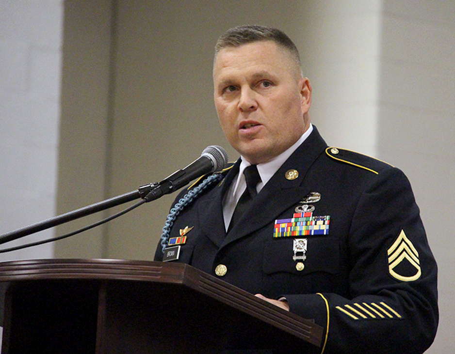 ROSS MARTIN/Citizen photo U.S. Army Reserves staff sergeant Jason Brown deleivered the keynote address during Platte County High School's Veterans Day Salute held Wednesday, Nov. 11. In addition to his military service, Brown also previously served as Platte County's presiding commissioner from 2011-2014.